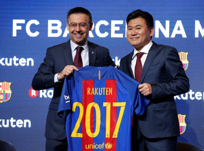 FC Barcelona's President Josep Maria Bartomeu and Rakuten's President with CEO Hiroshi Mikitani pose with a jersey after signing a contract as main sponsor in Barcelona