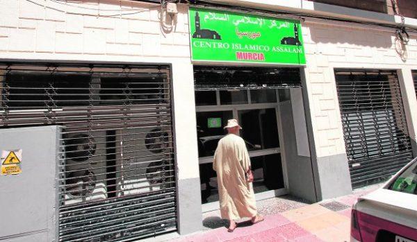 A Muslim enters a mosque located in the Murcian neighborhood of El Carmen.