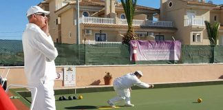 Dennis Birkett (Emerald Isle bowls club) sending one out in a Winter league match against Quesada