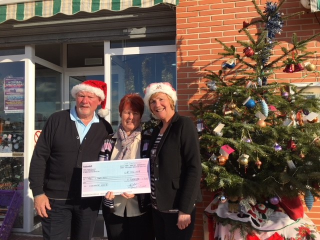 Mary Chambers, the representative of DEBRA receives a cheque for €1000 from Worshipful Brother Gordon Ramshead and his partner Sheila Fairbairn at their La Marina store