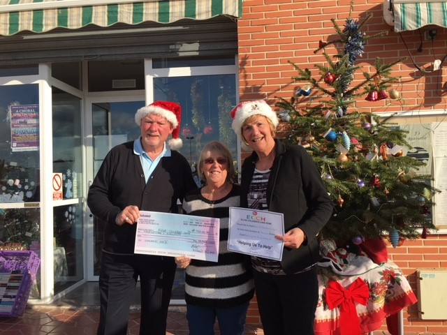 The picture shows Annette English of the Children's Home receiving a cheque for €760 from Worshipful Brother Gordon Ramshead and his partner Sheila Fairbairn.