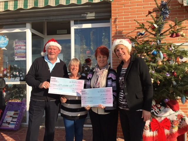 Masons of Dama de Elche Lodge donate money to local charities.
