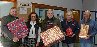members of the Branch together with the local Social Worker Doña Librada Mira Iñesta and just a few of the many presents