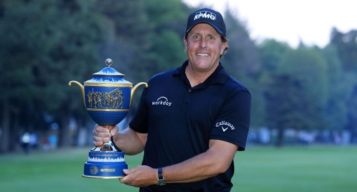 MEXICO CITY, MEXICO - MARCH 04: Phil Mickelson of the United States holds the Gene Sarazen Trophy after his play-off win during the final round of the World Golf Championships-Mexico Championship at the Club de Golf Chapultepec on March 4, 2018 in Mexico City, Mexico. (Photo by David Cannon/Getty Images)