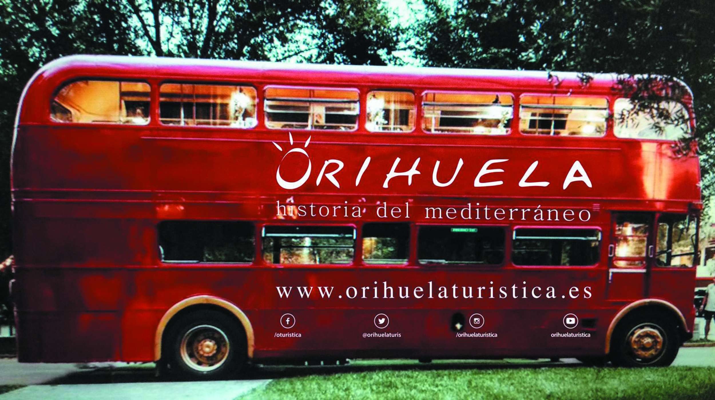 An English tourist bus liveried with the Orihuela brand driving around the centre of Madrid