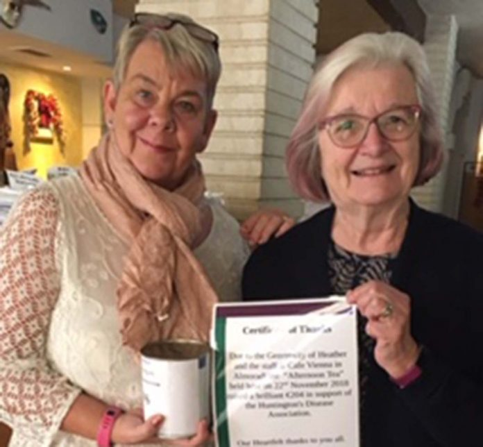 Heather receiving a certificate of thanks from Margaret Tozer, Association Treasurer.