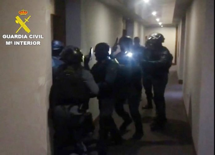 Guardia officers making arrests at a Cabo Roig Apartment