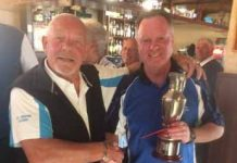 The photo shows Claret Jug being presented to Eddy Downing by the Vice Captain Brian Coultate