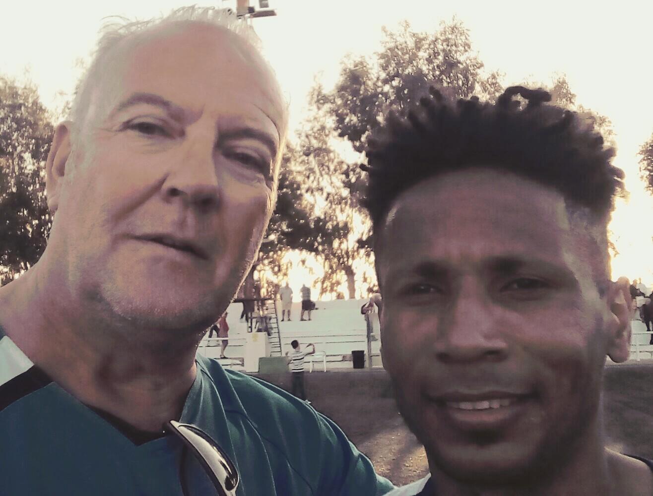 Reporter Andrew Atkinson with Montesinos scorer Vazquinho.