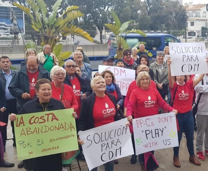 Employees and residents protesting in front of Playa Flamenca Town Hall against recent closure of Orihuela Costa Municipal Sports Centre