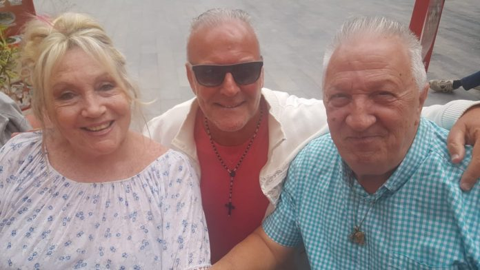 Norma and Esteban Fernandez with reporter Andrew Atkinson (centre) in Los Montesinos.