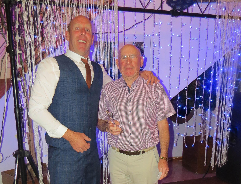Captain Eldon Carey with winner Ted Duffy