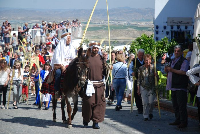 Mojácar holy week underway with The procession of the donkey on Palm Sunday