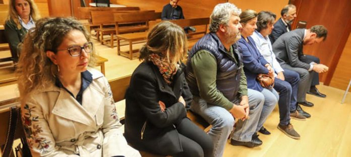 Ferrando (left) waiting to hear the court ruling