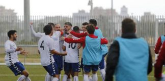 Players and subs mob Thales after scoring teams 4th goal.