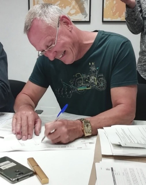 Chris Knight (TCF Pastor) signing for new Church Building on Wednesday, 17th April 2019