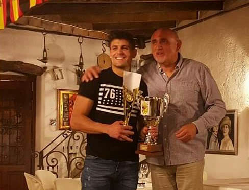 Carlos Lorente presented with the Full Monte Player of the Year award by supporters club President Eddie Cagigao.