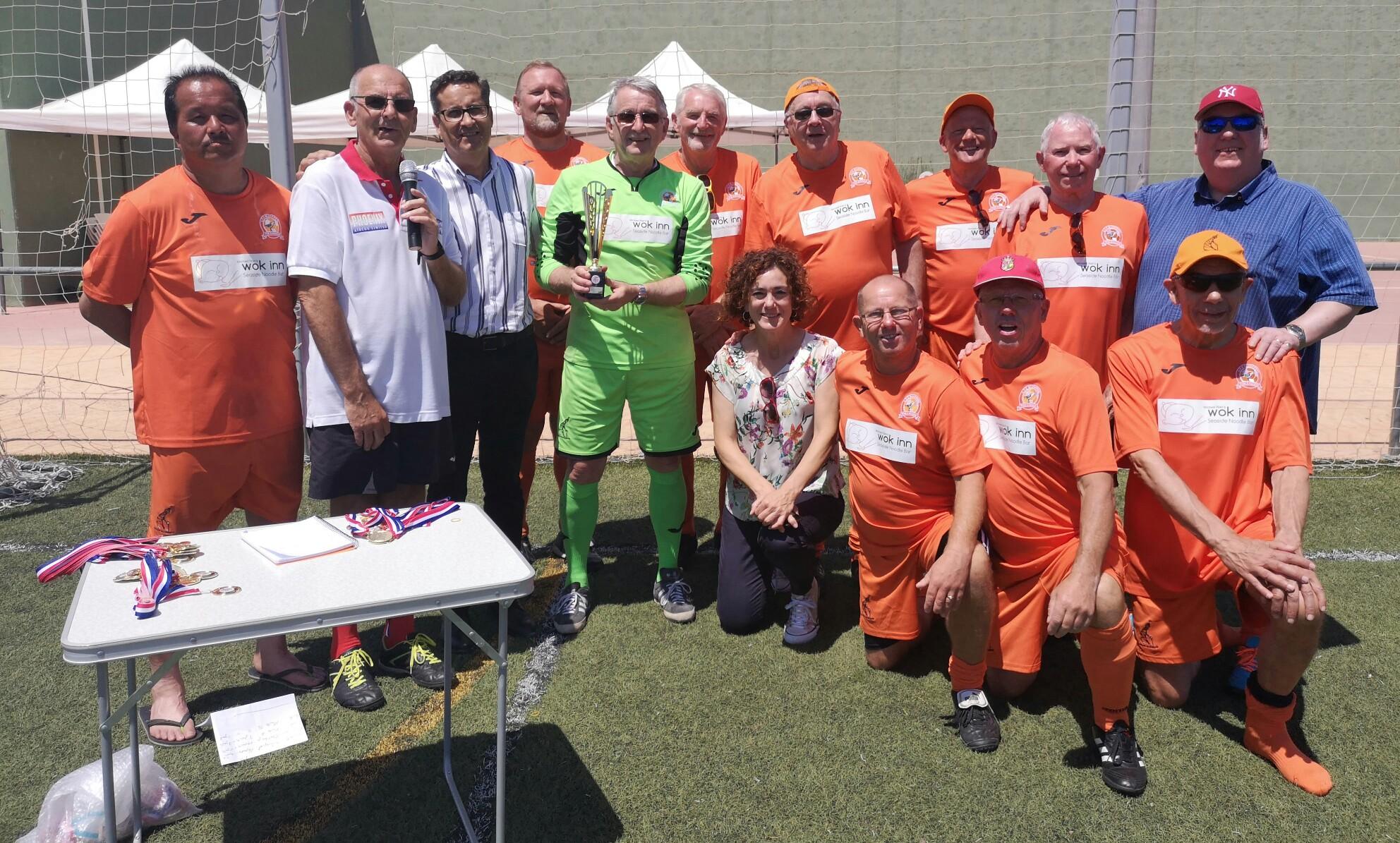 Los Montesinos Mayor José Manuel Butron and deputy Mayor Anna Belen with winners AFC Blackpool senior Seasiders.