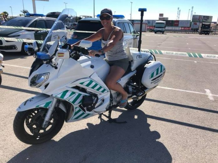 Local resident Nicola Louden exchanges her pushbike for a Guardia Yamaha with just a bit more power