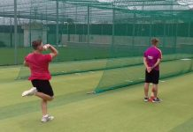 Connor Wood bowling, with Tommy Knowles umpiring, during training.