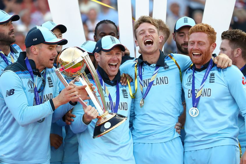 England Captain Eoin Morgan lifts the World Cup with the England team after victory for England during the Final of the ICC Cricket World Cup 2019 between New Zealand and England at Lord's Cricket Ground on July 14, 2019 in London, England.