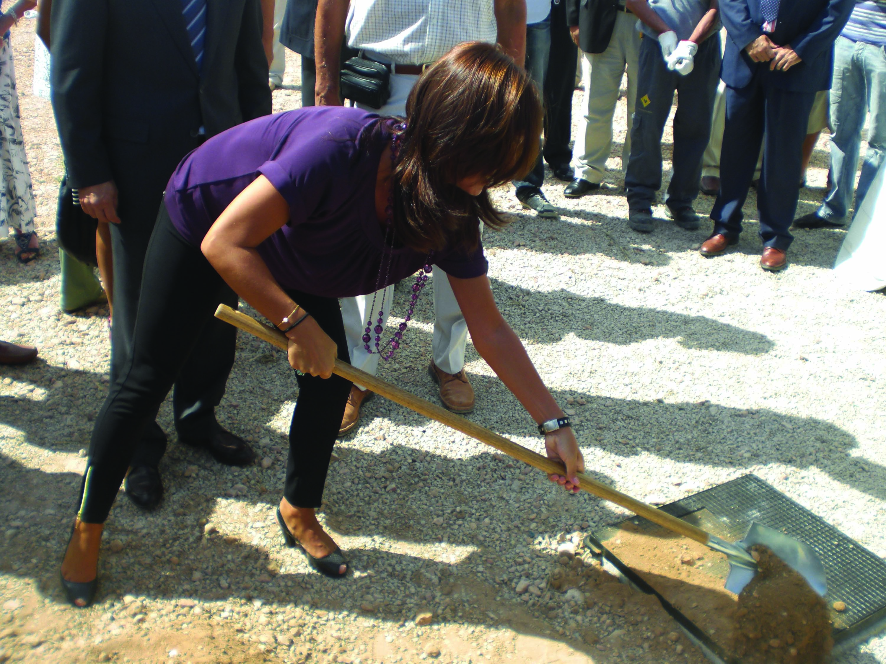 The Mayor Monica LOrente covering the time capsule in 2010