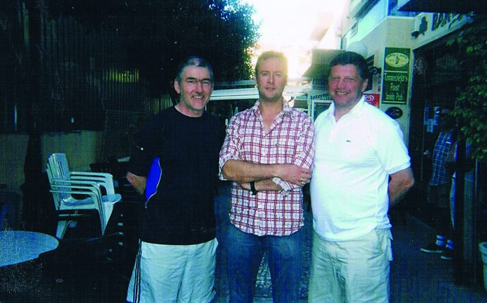 Son Ian pictured with legendary GAA football managers, Mickey Harte, (L) and John O'Mahony, (R) during a trip to La Zenia