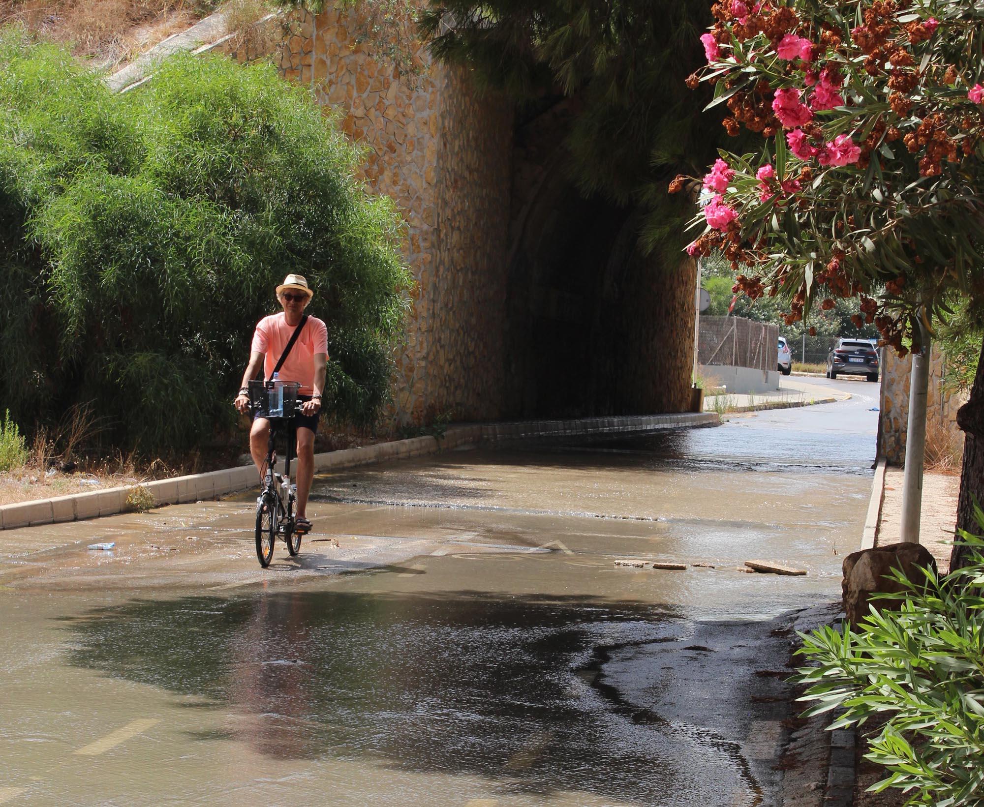 On his way to La Zenia Beach through the village. Cycling through raw sewage.
