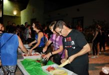 Los Montesinos Mayor Jose Manuel Butron helps prepare food at the Traversia Nocturna La Marquesa.
