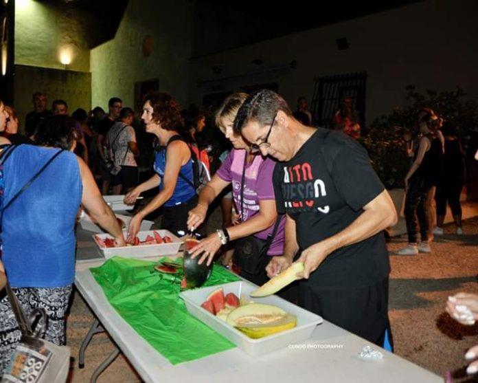 Los Montesinos Mayor Jose Manuel Butron helps prepare food at the Traversia Nocturna La Marquesa.