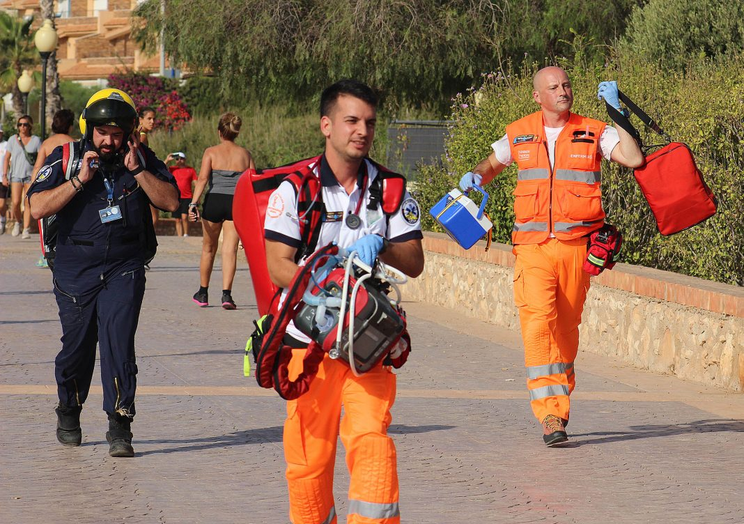 Air ambulance paramedics running to the scene of the accident