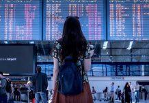 Teenager looking at flight board