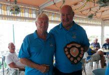 Photo of 2018 winner Graham ball presenting the shield to 2019 winner Ian Allison.