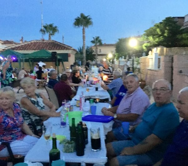 Spanish and English friends and neighbours enjoying the evening