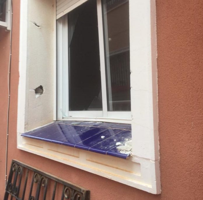 Burglars used a car jack to rip out metal grill.
