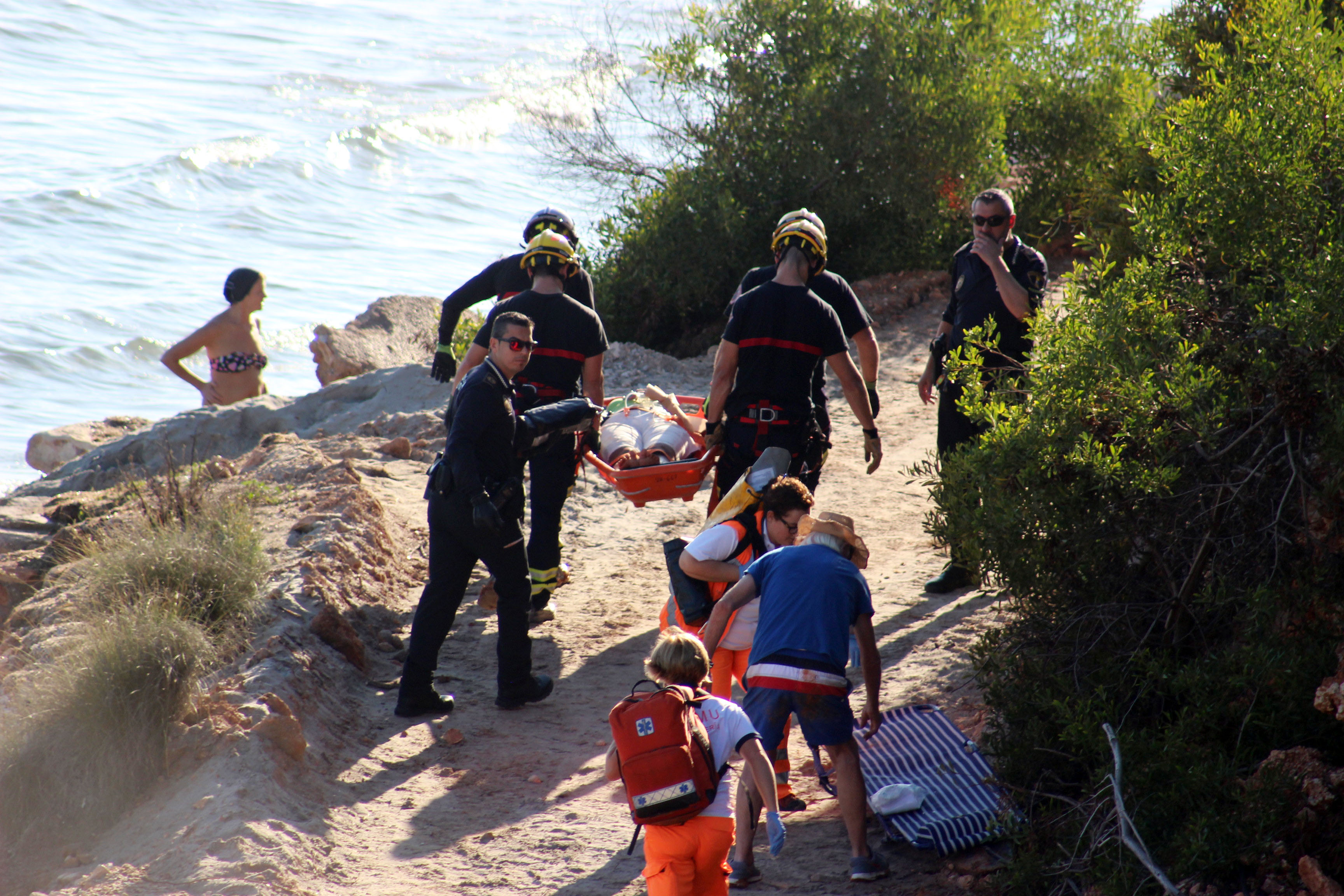 The injured lady was stretchered off the beach