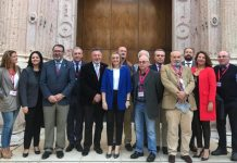 Minister for Planning, Marifrán Carazo, (centre) with members of parliament and representatives of homeowners groups