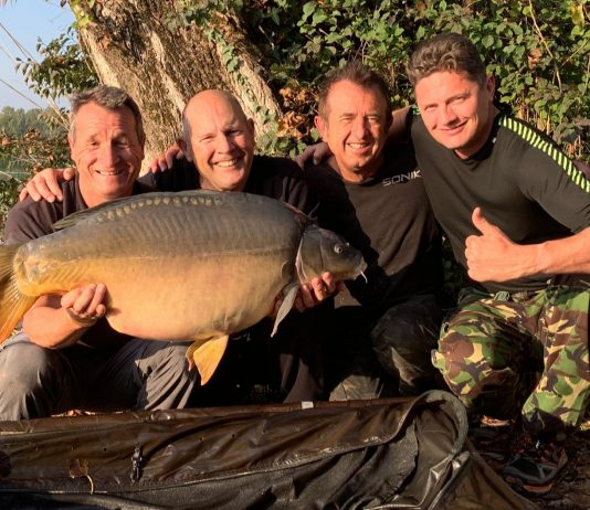 John Fisher (second, left) with a 43lb mirror carp, landed at Parco Del Brenta Lake, Italy.