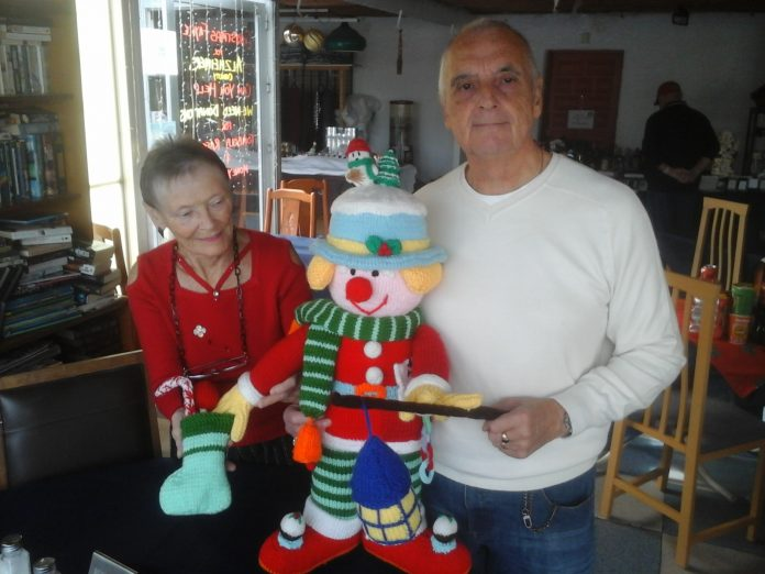 The photo shows David and Lorraine Whitney getting ready for the event