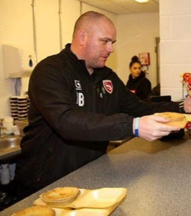 Ex-Morecambe boss Jim Bentley is seen in the main image serving pies.