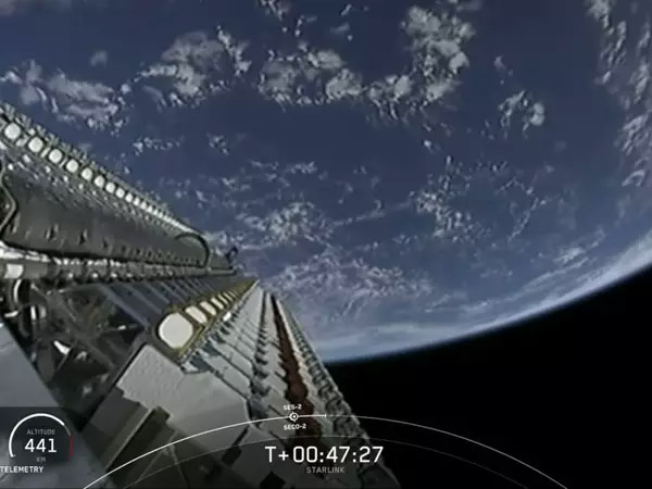 A frame from a live video feed shows a SpaceX Falcon 9 rocket delivering a starlink satellites into orbit ..
