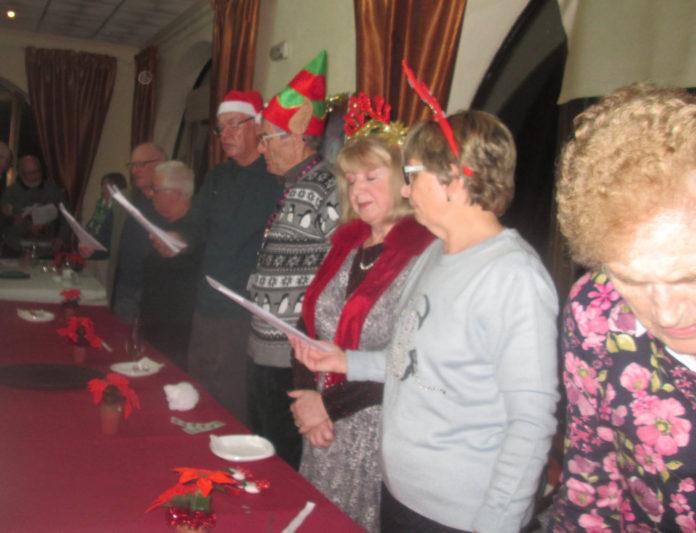 Carols close Torrevieja RBL Christmas Meeting