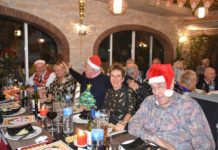 Local Freemasons sing Carols for charity.