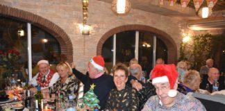 Local Freemasons sing Carols for charity.