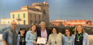 The mayor of Pilar de la Horadada, José María Perez, is shown in the photograph congratulating staff from the tourism office