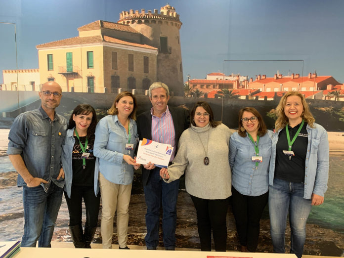 The mayor of Pilar de la Horadada, José María Perez, is shown in the photograph congratulating staff from the tourism office