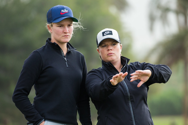 Lydia Hall of Wales shows Amy Walsh the way to paly the hole