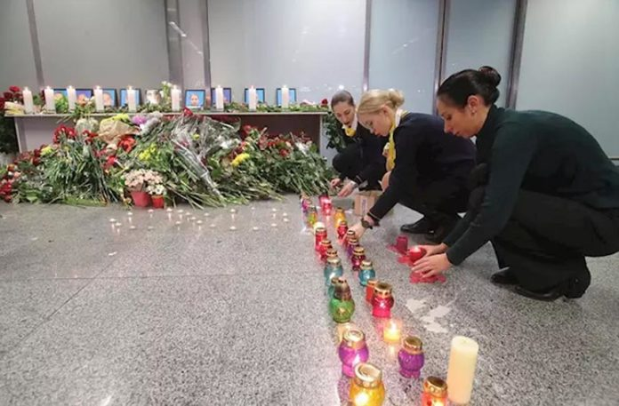 Airline employees lghting candles for the crash victims
