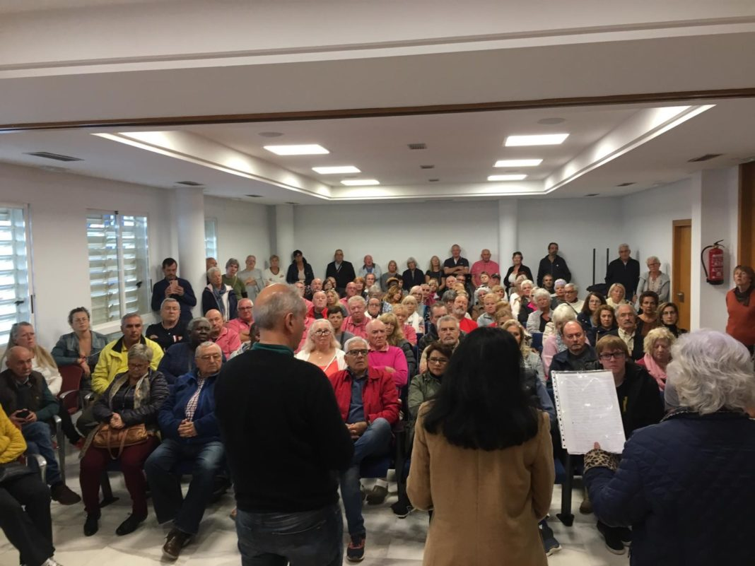 At full to overflowing meeting in in Orihuela Costa Town Hall, Councillor for Sports providing explanations as to delay in reopening fully functioning sports centre