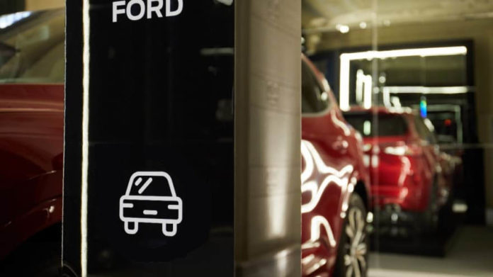 FORD TEMPORARILY SUSPENDS EUROPEAN PRODUCTION